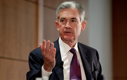 Fed Chair Jay Powell suggests that the recent surge in U.S. business debt poses moderate risks to the economy.